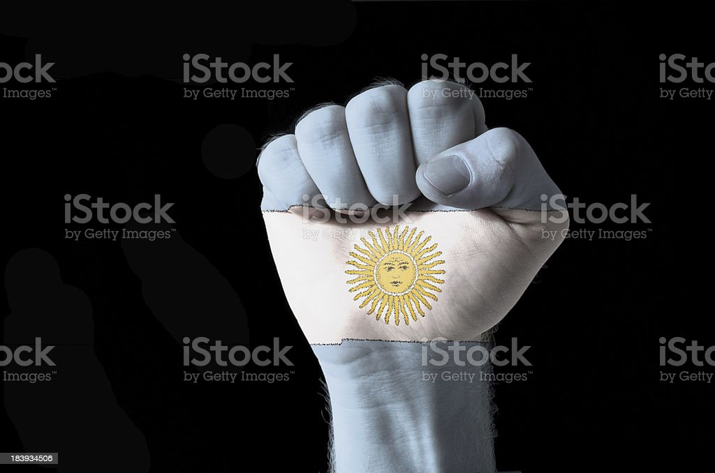 Fist painted in colors of argentina flag stock photo