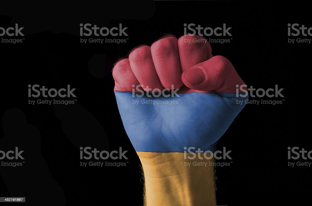 Fist painted in colors of armenia flag stock photo