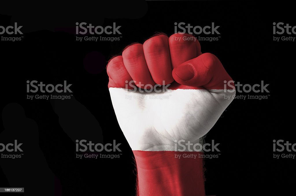Fist painted in colors of austria flag royalty-free stock photo