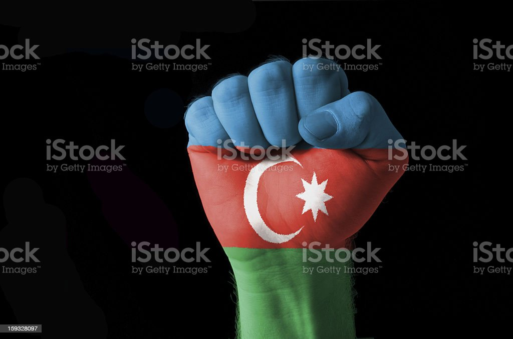 Fist painted in colors of azerbaijan flag stock photo