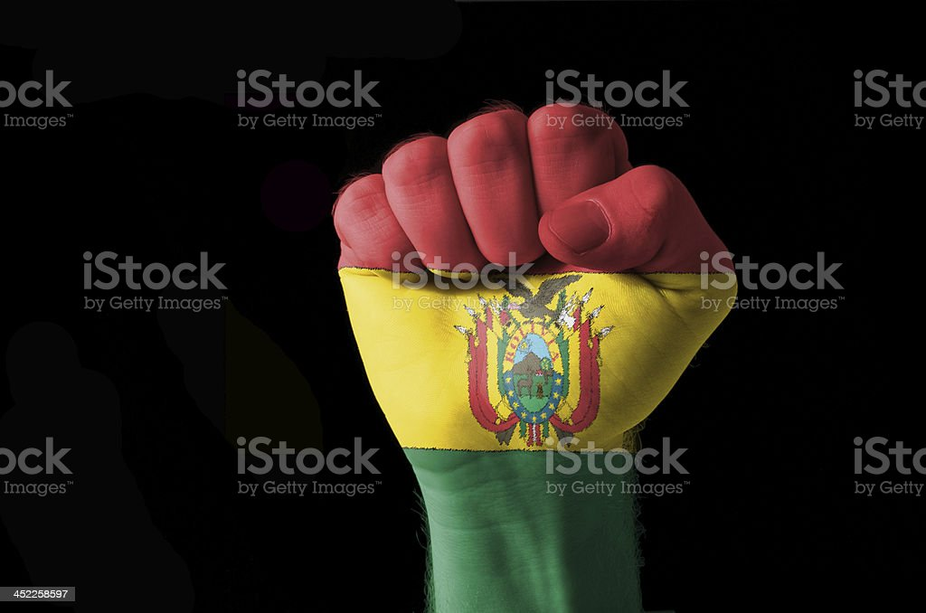 Fist painted in colors of bolivia flag stock photo