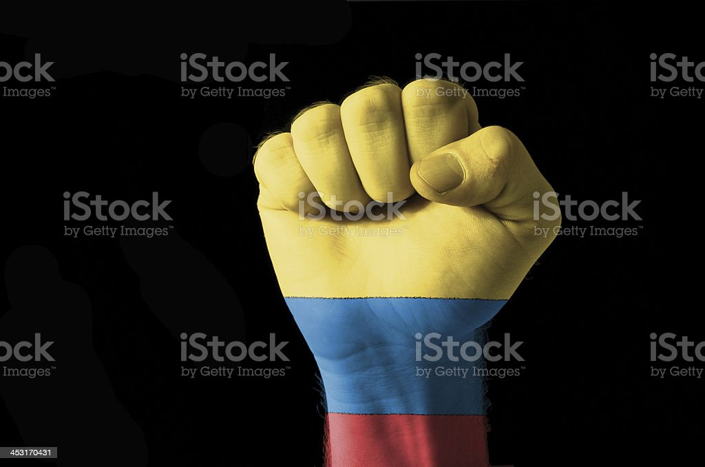Fist painted in colors of colombia flag stock photo