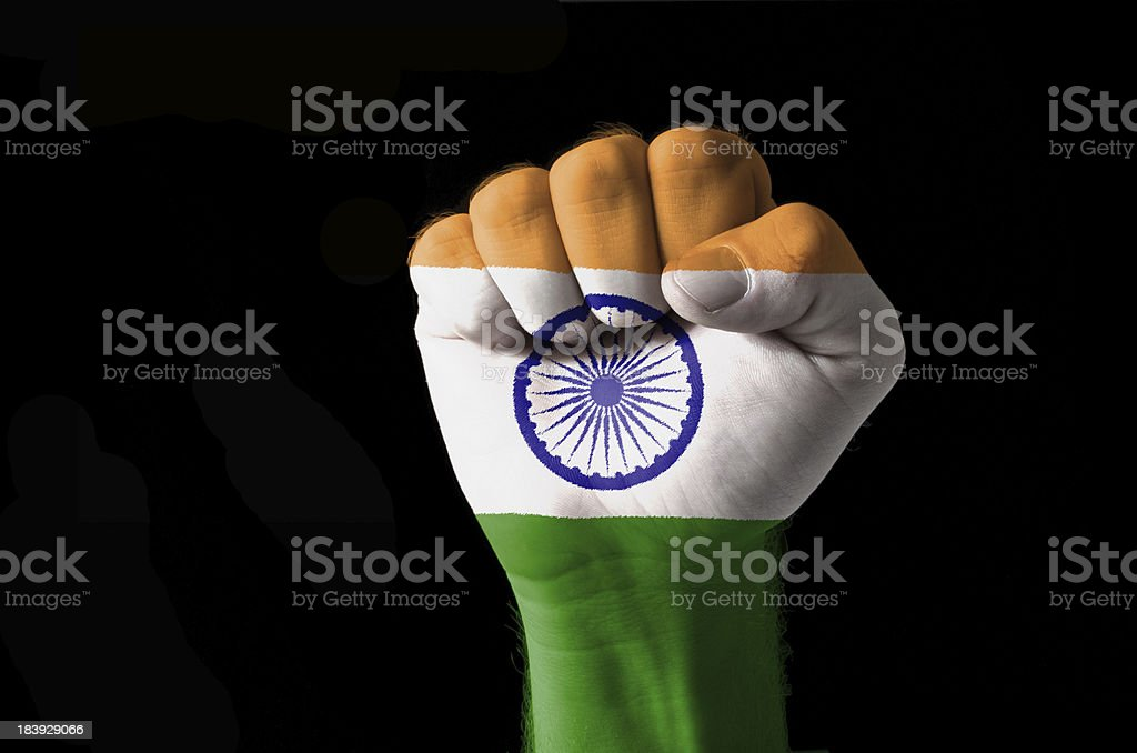 Fist painted in colors of india flag stock photo
