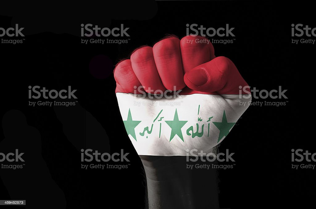 Fist painted in colors of iraq flag stock photo
