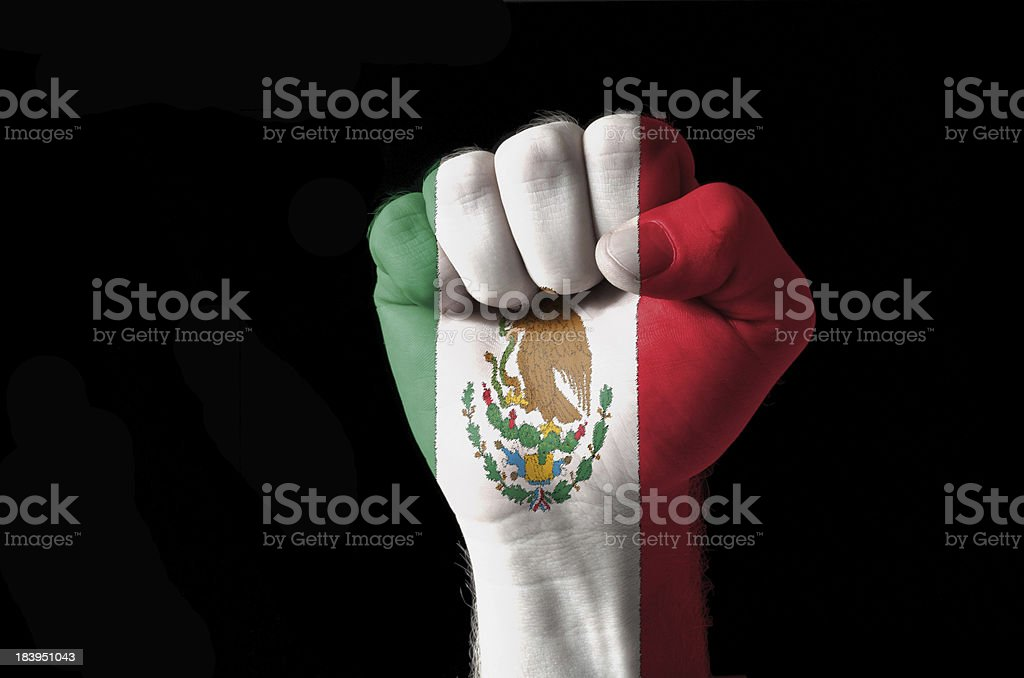 Fist painted in colors of mexico flag stock photo