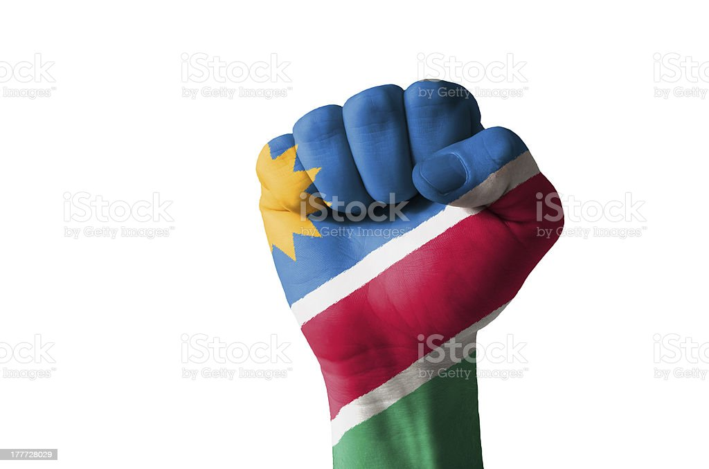 Fist painted in colors of namibia flag stock photo
