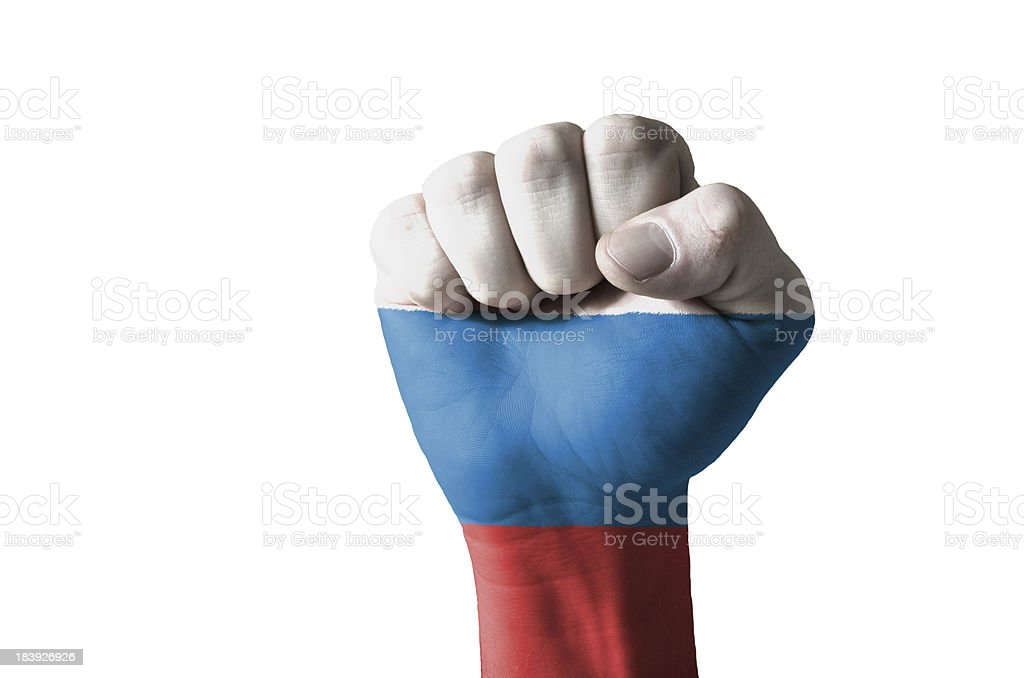 Fist painted in colors of russia flag stock photo