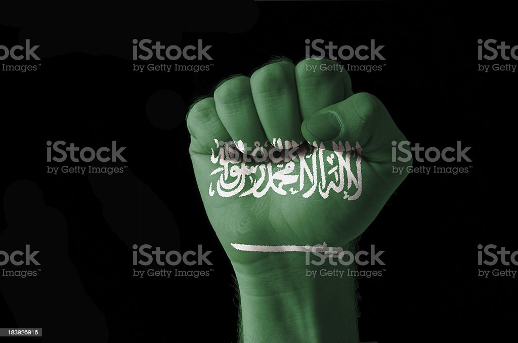 Fist painted in colors of saudi arabia flag stock photo