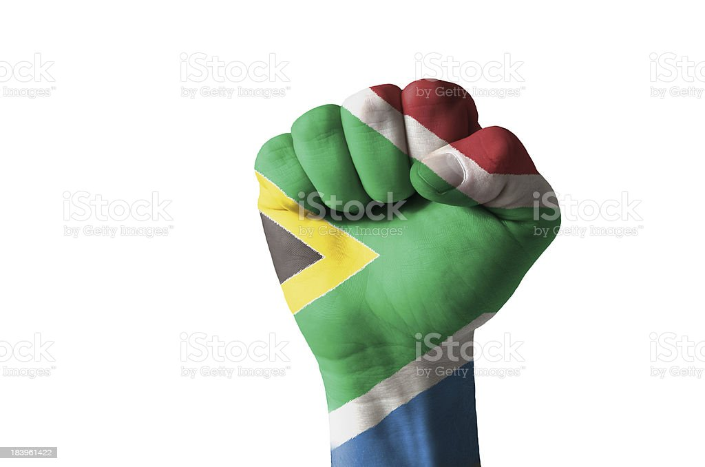 Fist painted in colors of south africa flag royalty-free stock photo