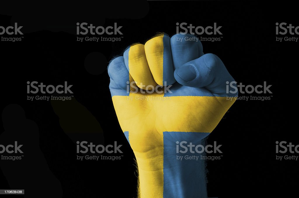 Fist painted in colors of sweden flag stock photo