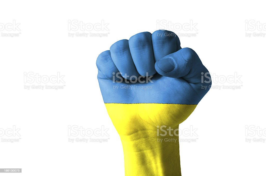 Fist painted in colors of ukraine flag royalty-free stock photo