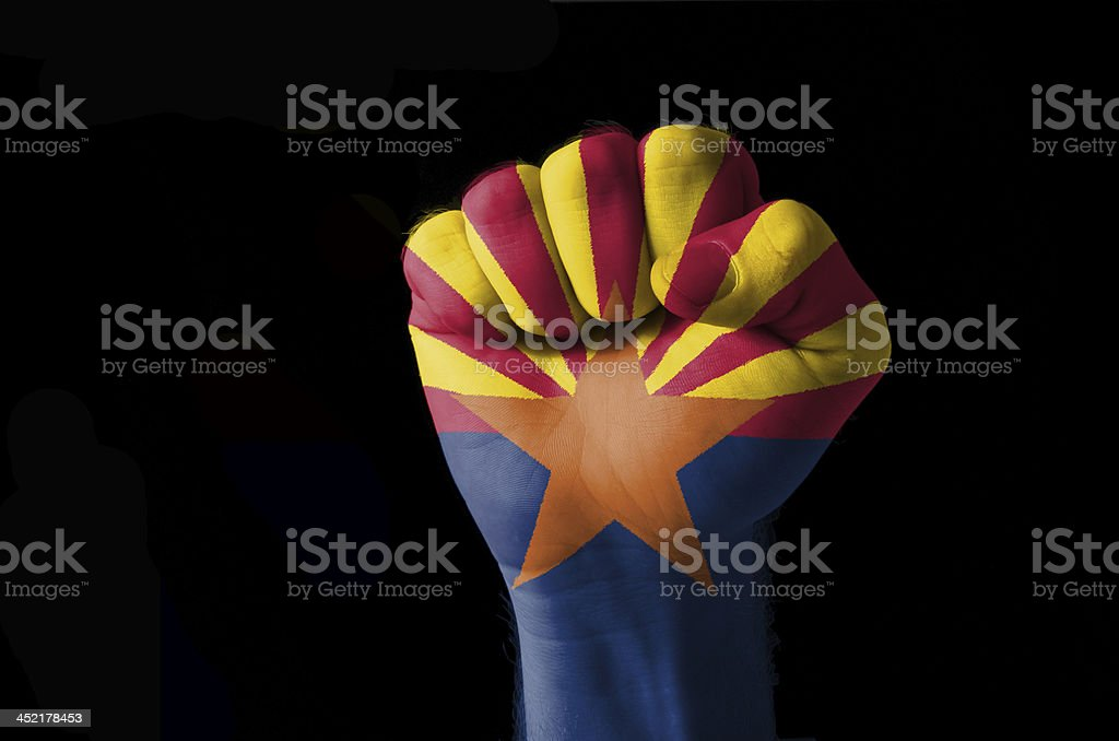 Fist painted in colors of us state arizona flag stock photo