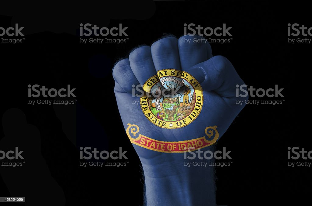 Fist painted in colors of us state idaho flag stock photo