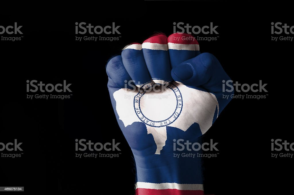 Fist painted in colors of us state of wyoming flag stock photo
