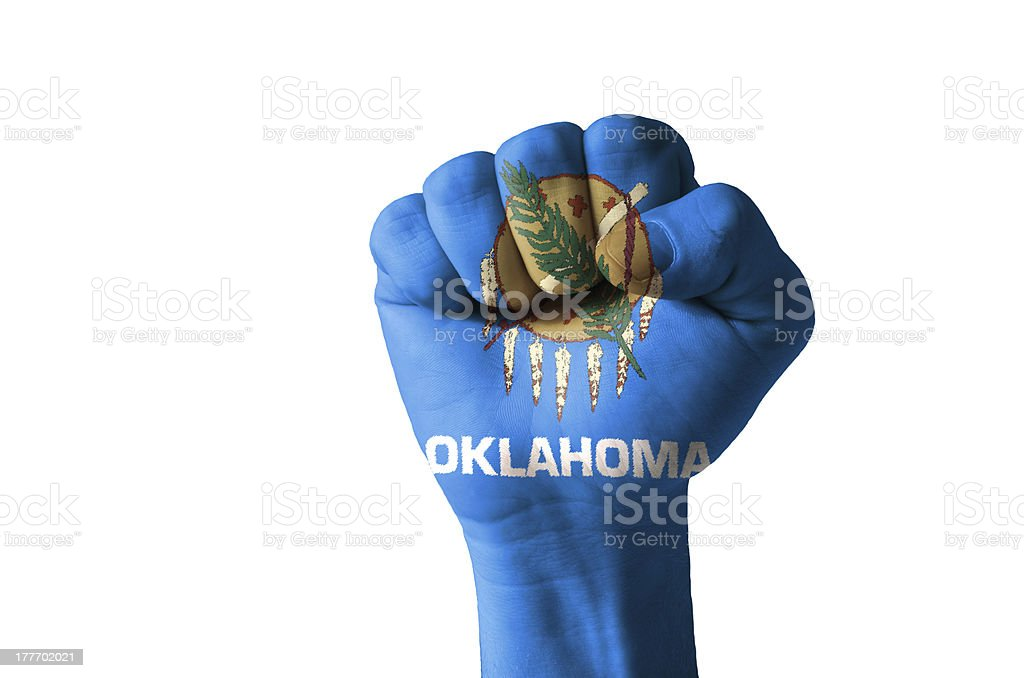 Fist painted in colors of us state oklahoma flag stock photo