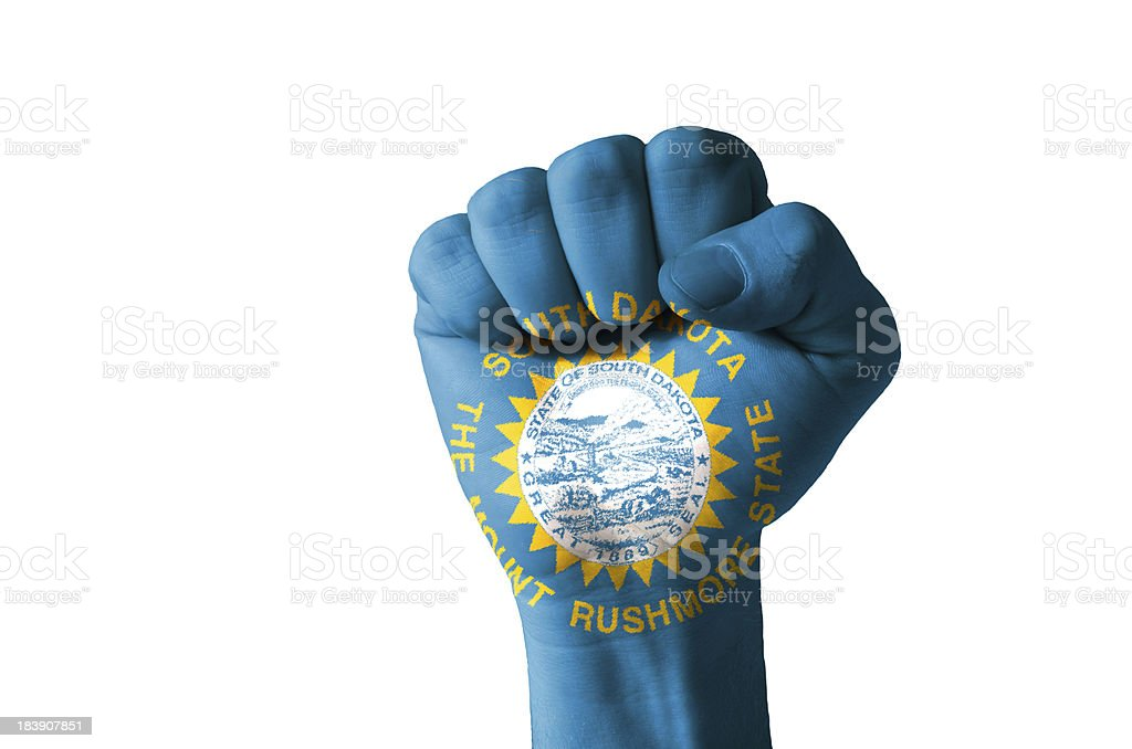Fist painted in colors of us state south dakota flag stock photo