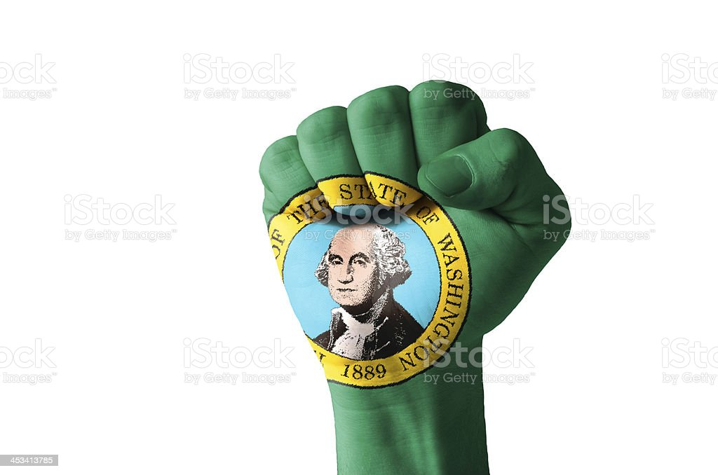 Fist painted in colors of us state washington flag stock photo