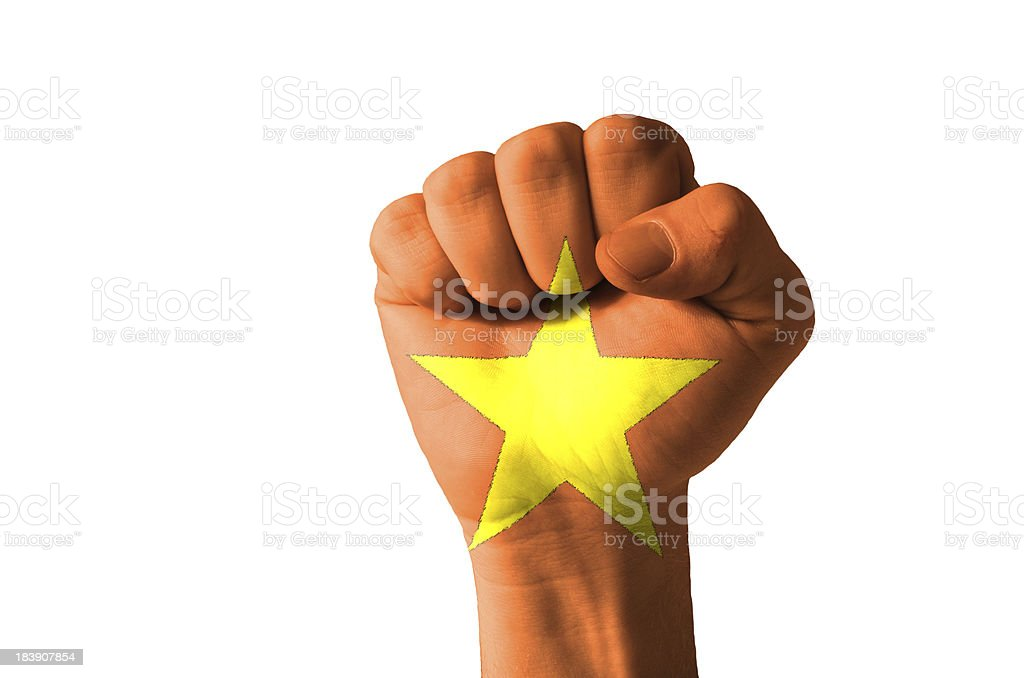 Fist painted in colors of vietnam flag stock photo