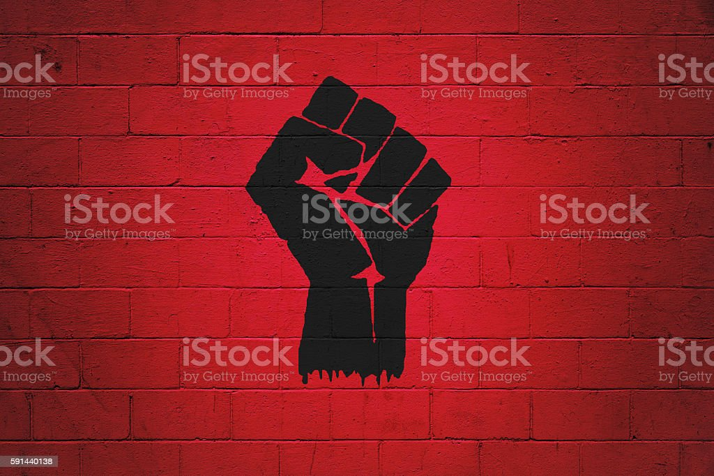 Fist power painted on a wall stock photo