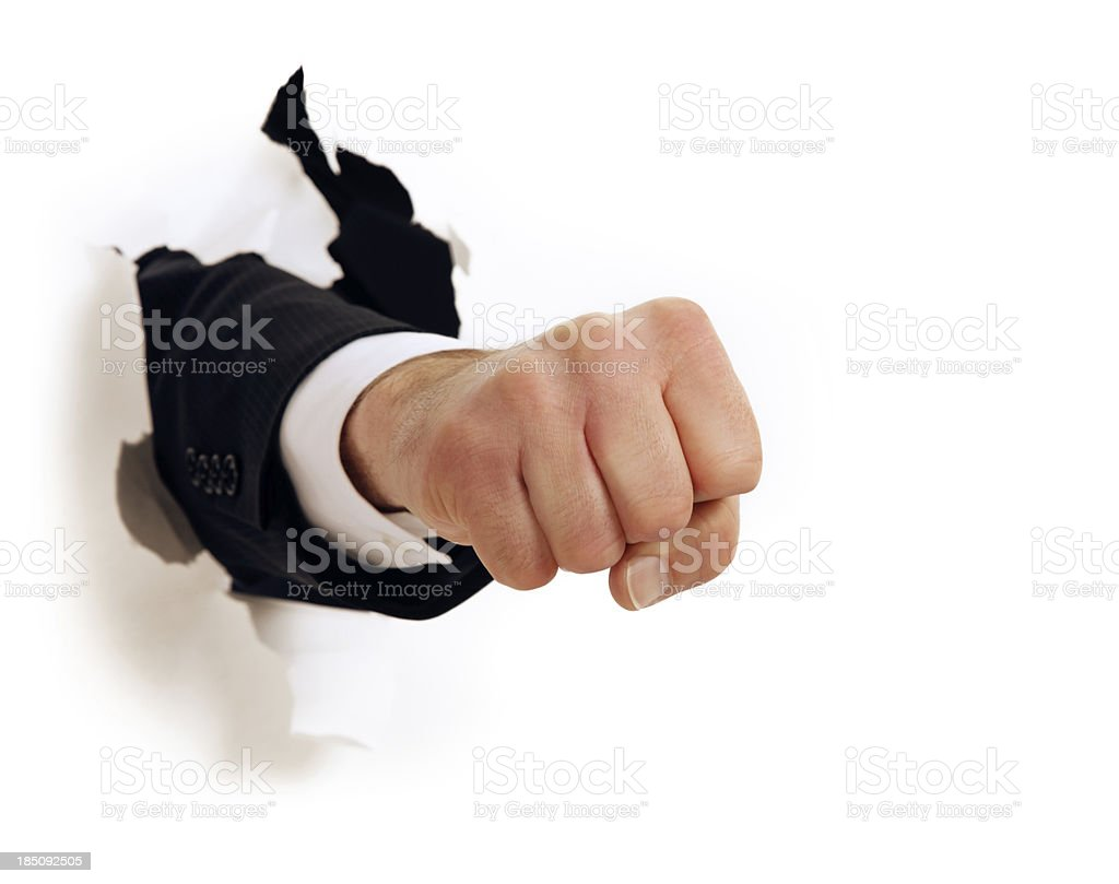 Fist Punch Through White Paper stock photo