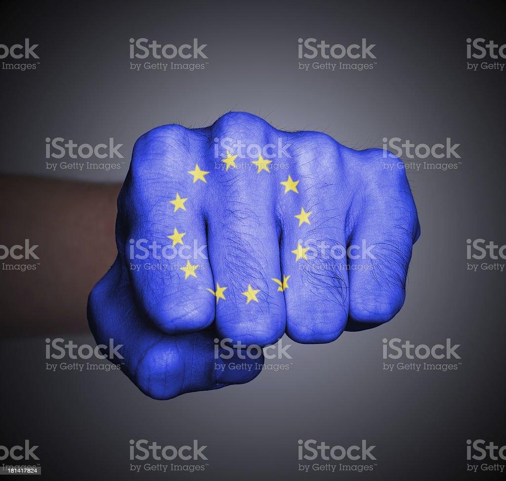 Fist punching, EU flag pattern royalty-free stock photo
