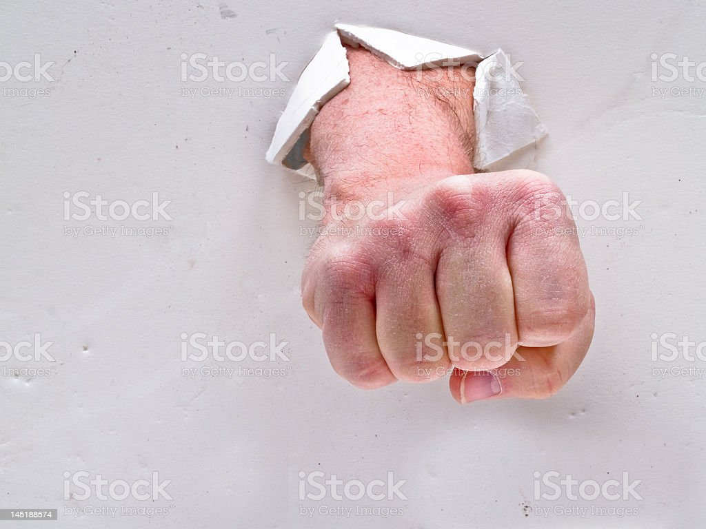 Fist Through Wall stock photo
