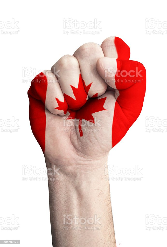 Fist with flag of Canada stock photo