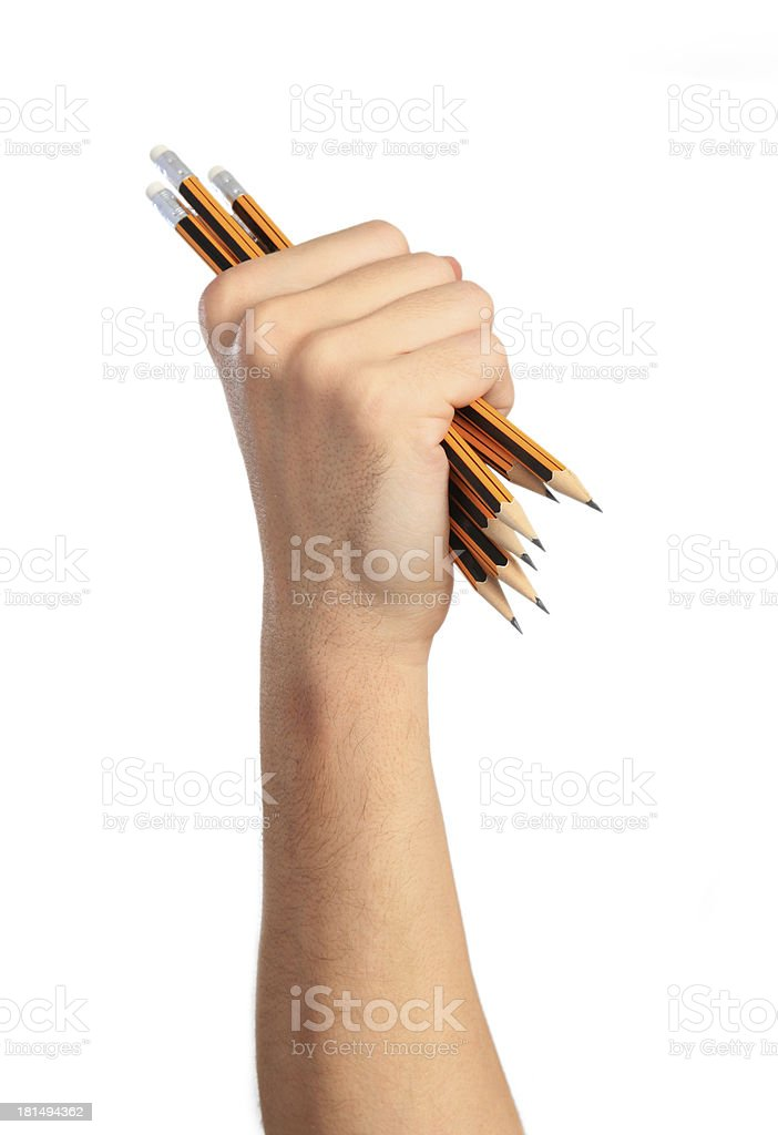 Fist with pencils royalty-free stock photo