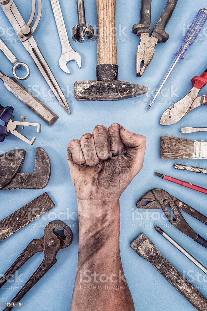 fist with work tools - worker concept stock photo