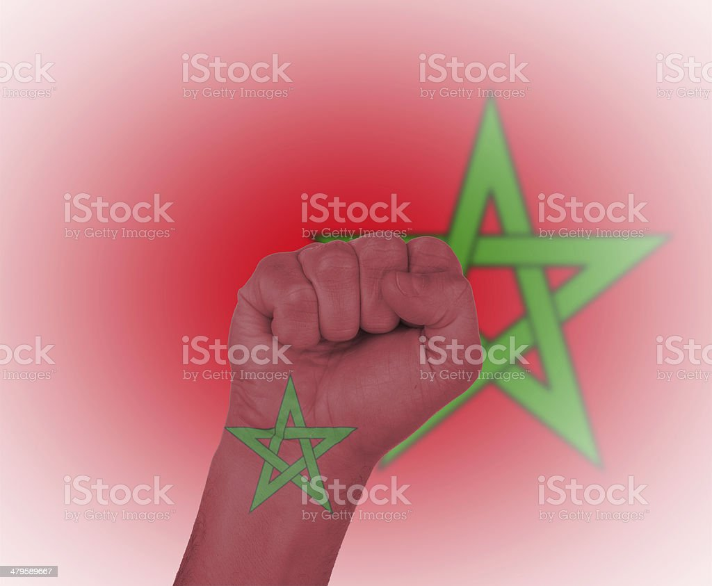 Fist wrapped in the flag of Morocco stock photo