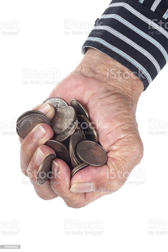 Fistful of coins royalty-free stock photo