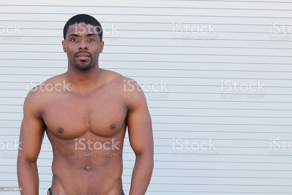 Fit African man over white background stock photo