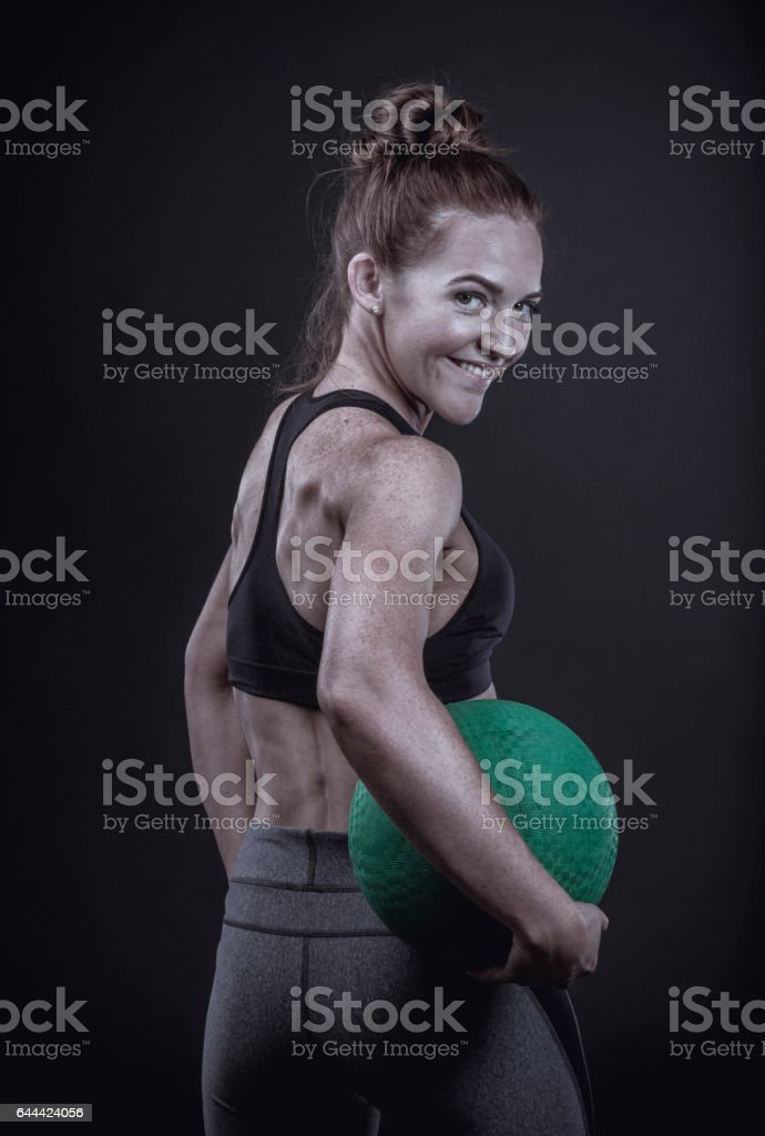Fit and Happy Woman Holding an Exercise Ball stock photo
