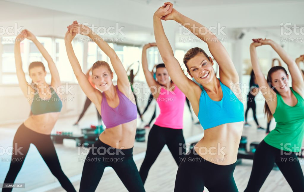 Fit and healthy women exercising stock photo