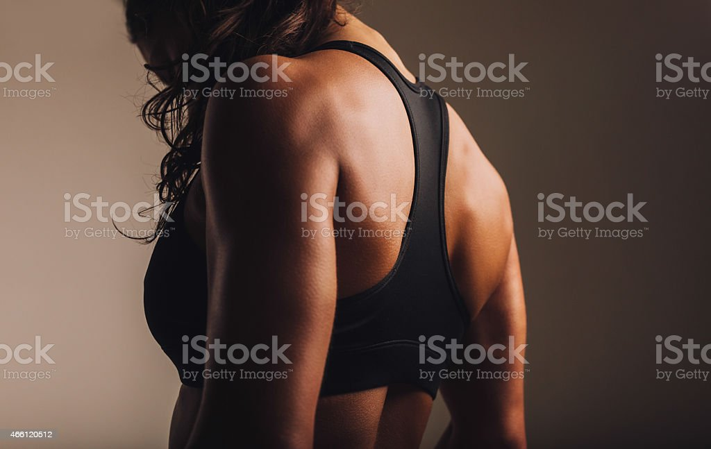 Fit and muscular woman in sports bra stock photo