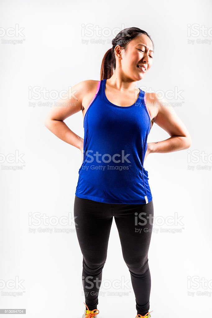 Fit Asian woman with a back injury stock photo