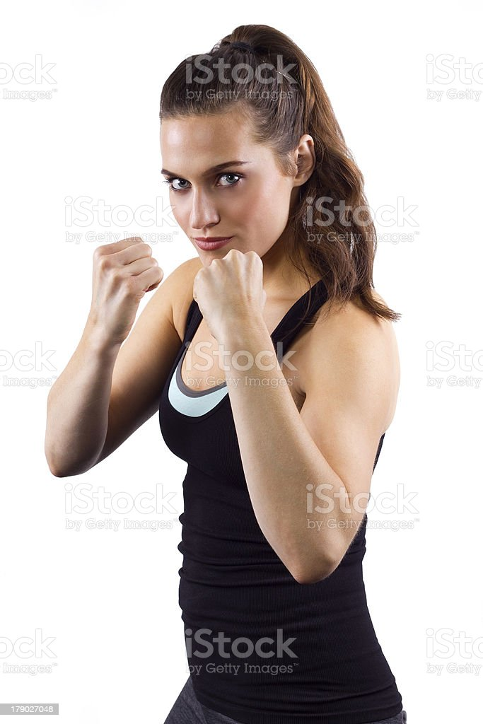 young female mixed martial arts fighter on a fighting stance