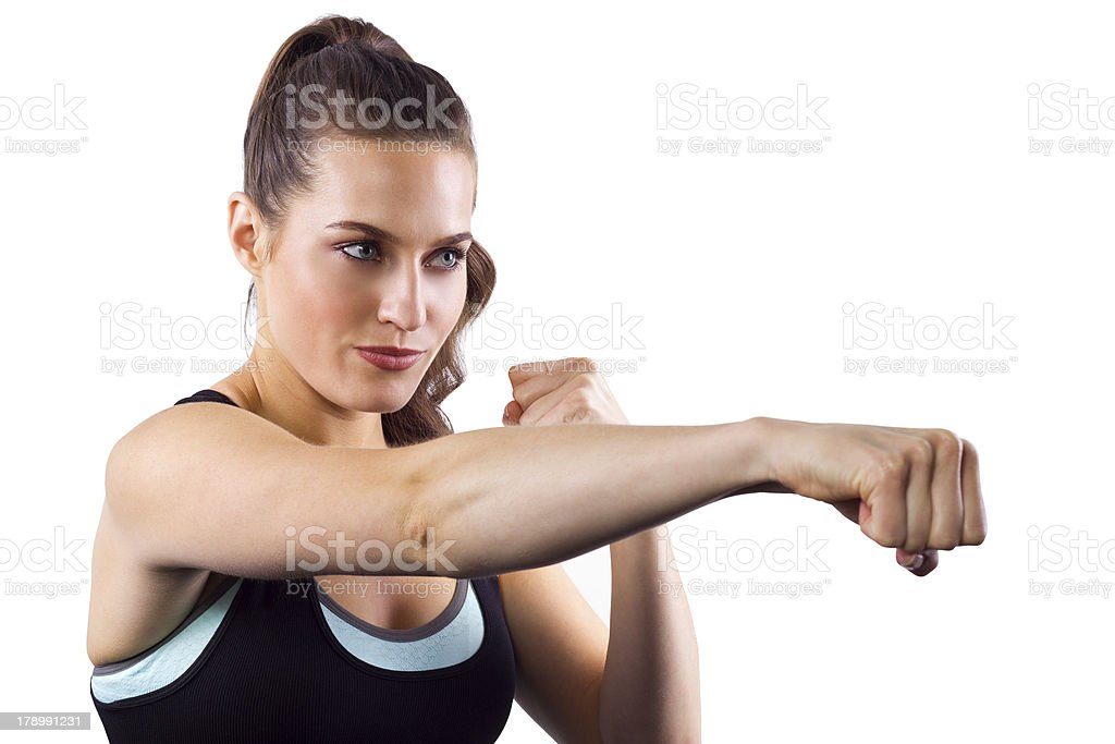 Fit Beautiful Female MMA Fighter in a Fighting Stance Punching royalty-free stock photo