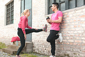 Fit couple doing exercises