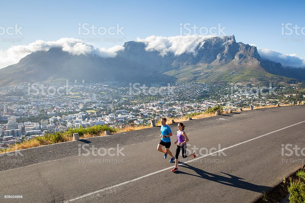 Fit couple enjoying a run in the city stock photo