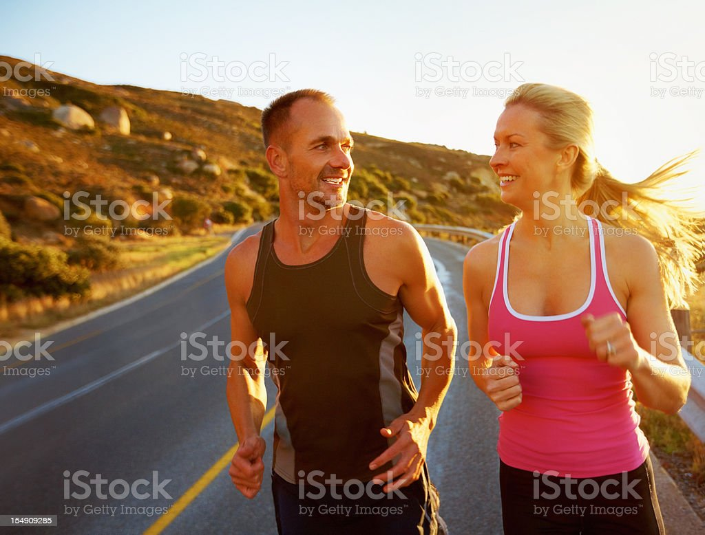 Fit couple going for run stock photo