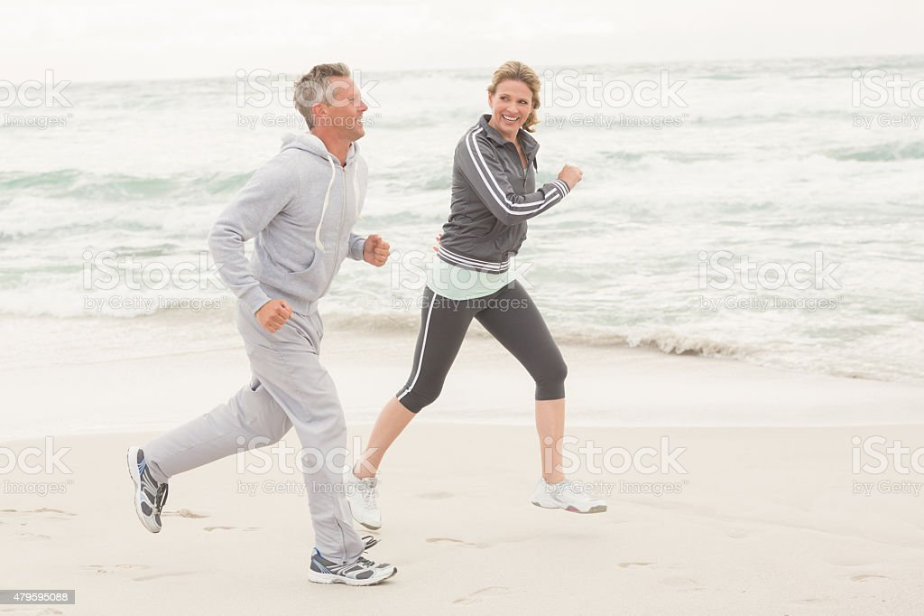 Fit couple jogging together stock photo