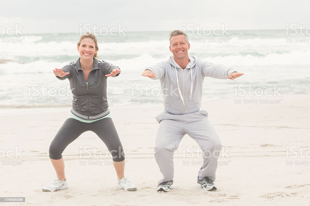 Fit couple smiling at camera stock photo