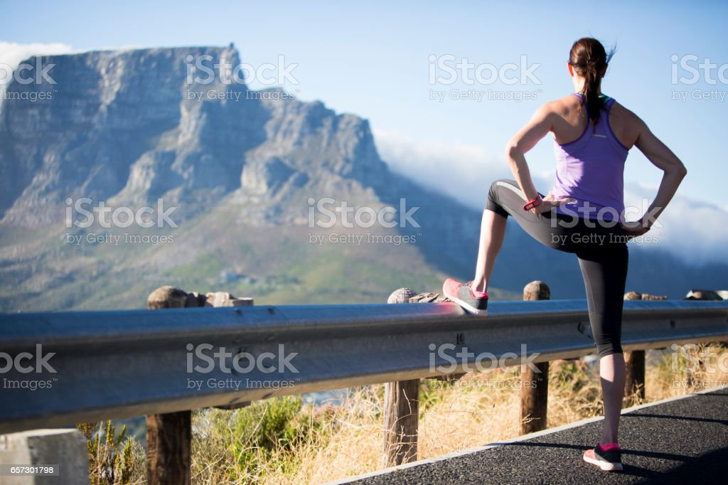 Fit female admires the view of Table Mountain stock photo