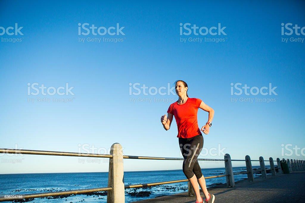 Fit female Enjoying her morning run stock photo