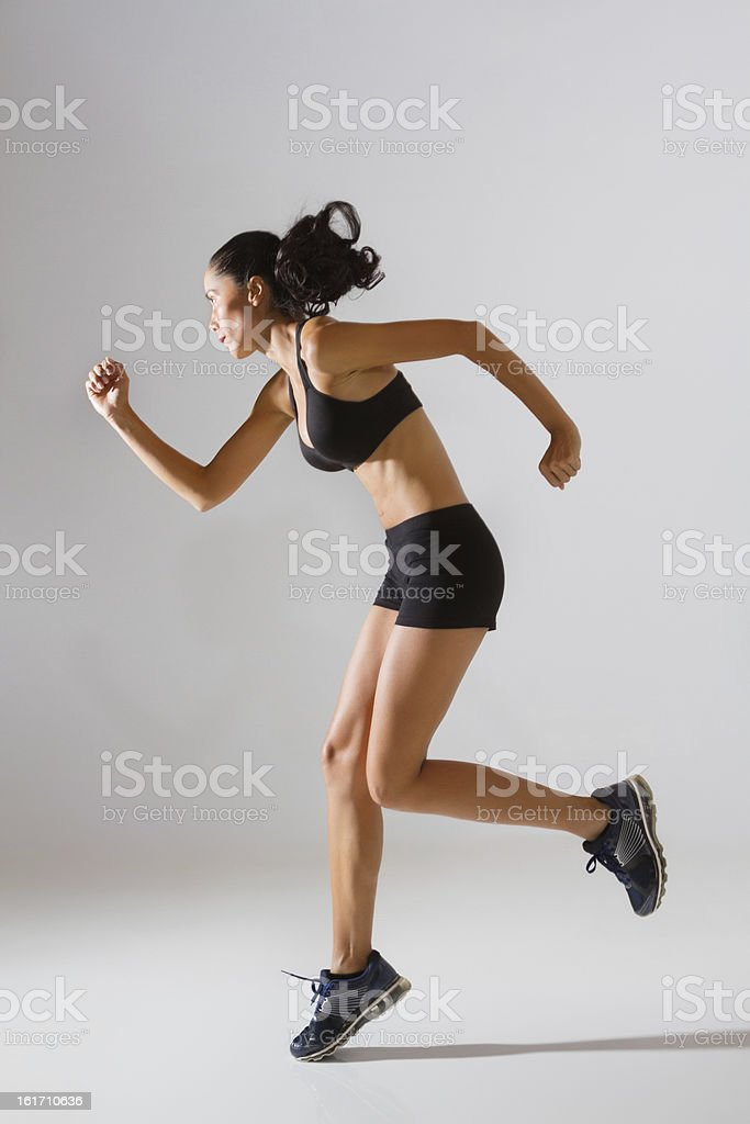 Fit Female In Sports Bra And Shorts Jogging royalty-free stock photo