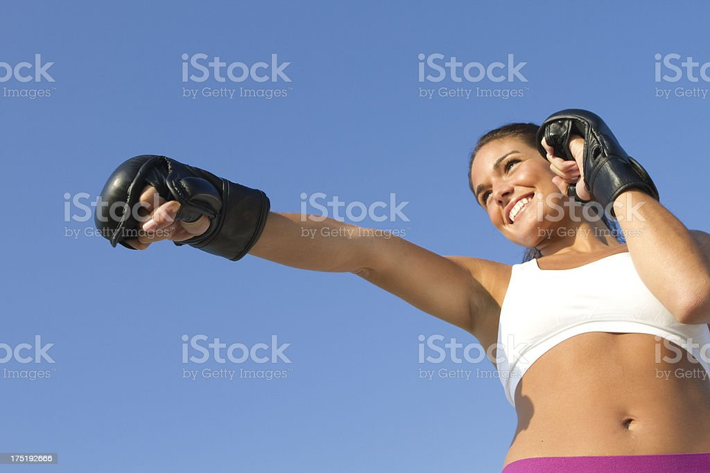 fit girl boxing outdoors royalty-free stock photo