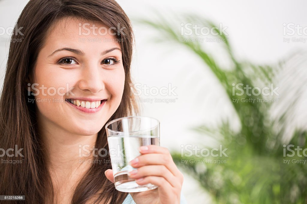 Fit girl drinking mineral water stock photo