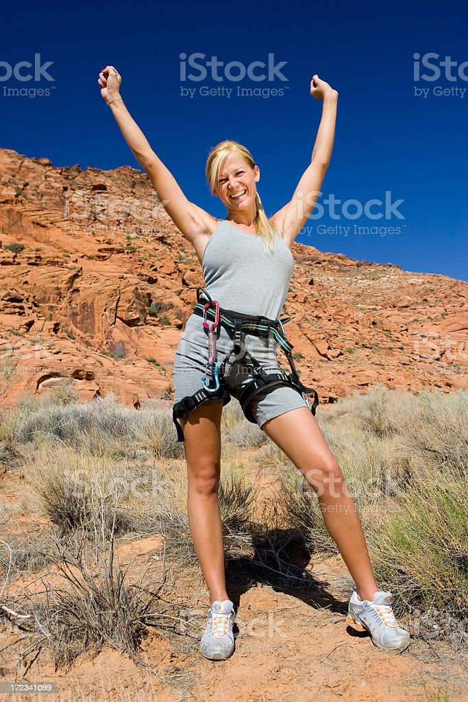 Fit Girl in Desert with Arms Raised royalty-free stock photo