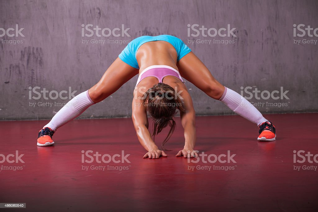 Fit girl stretching before running. stock photo